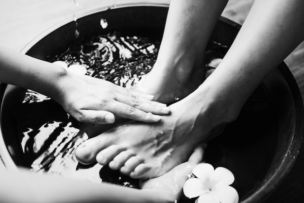 Closeup offeet spa therapy and massage