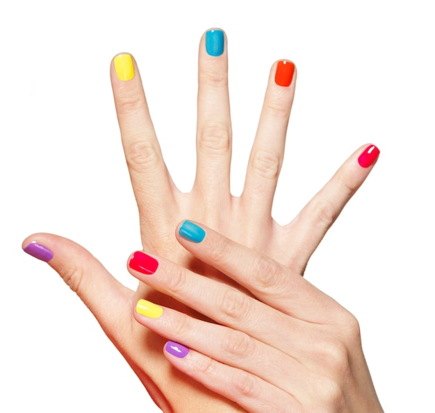 Closeup female hand with  multicolor nails over white.