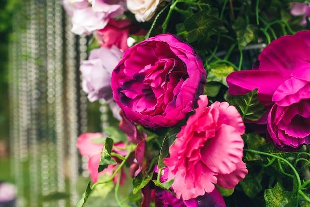 Closeup floral decor of a wedding arch.