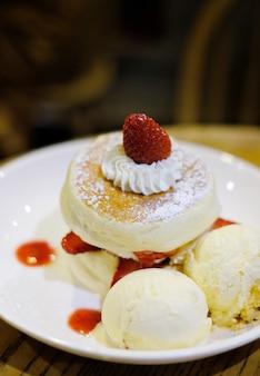 Closeup fluffy pancake with fresh strawberry