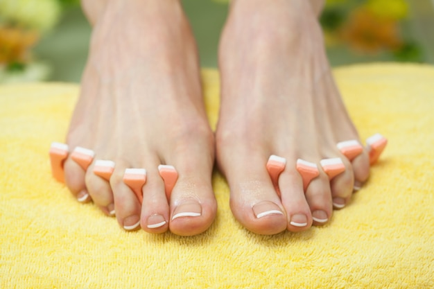 Closeup of french pedicured feet