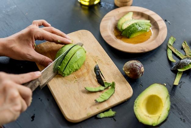 Closeup of fresh avocado on wooden cut board