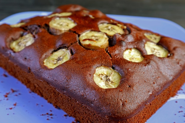 Closeup fresh baked delectable homemade wholemeal chocolate banana olive oil cake