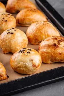 Closeup on fresh baked oriental pies samsa on a tray