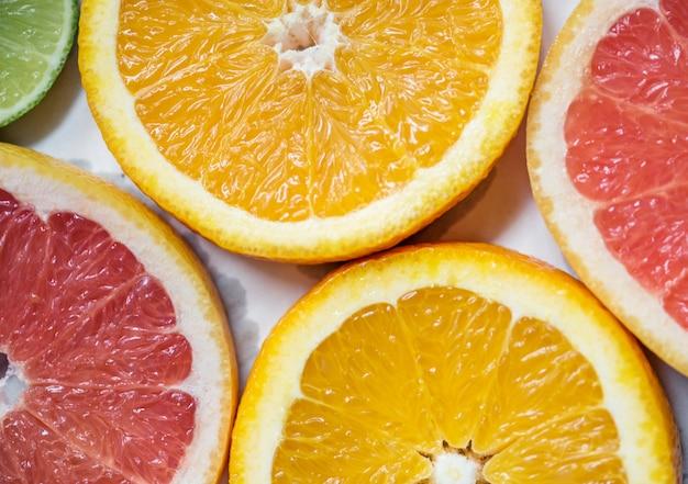 Closeup of fresh citrus fruit slices background