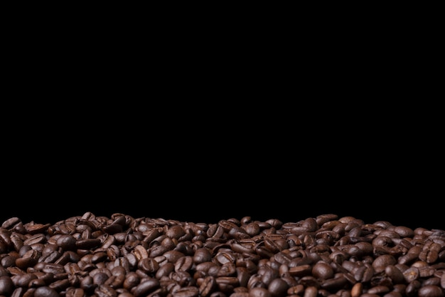 Closeup fresh coffee bean background with copyspace
