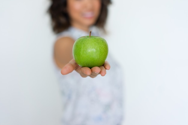 Closeup of fresh green apple on woman hand