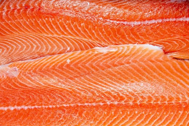 Closeup fresh norwegian salmon fillet fish on professional restaurant kitchen.
