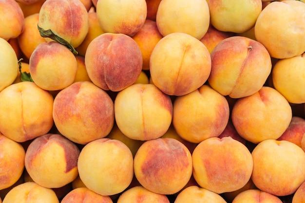 Closeup of fresh ripe peaches background