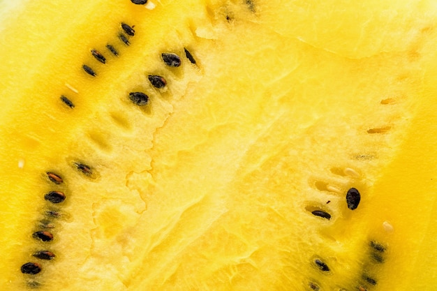 Closeup of fresh yellow watermelon slices on plate