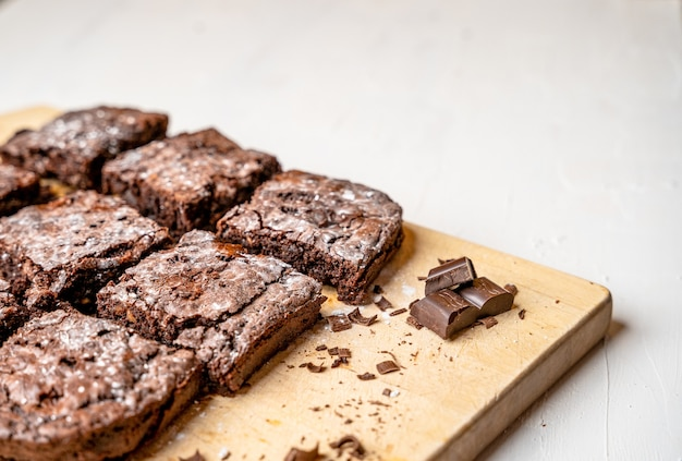 Closeup of freshly baked brownies on a wooden board