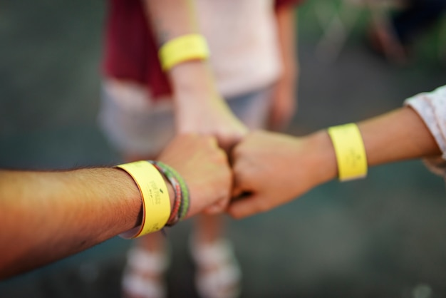 Closeup of friends put fits together unity