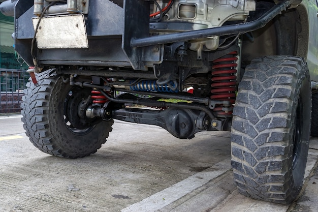 Closeup front wheel and suspension of the four-wheel drive pickup truck.