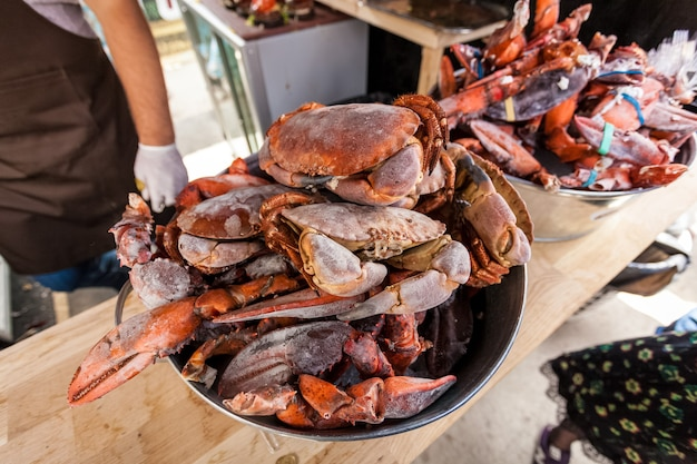 Closeup of frozen crabs and lobster claws at restaurant kitchen