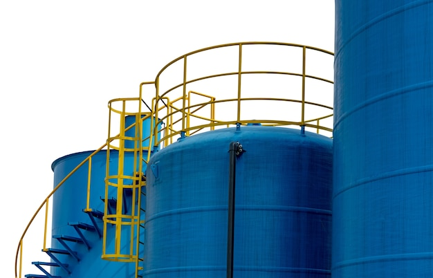 Closeup fuel storage tank in petroleum refinery.