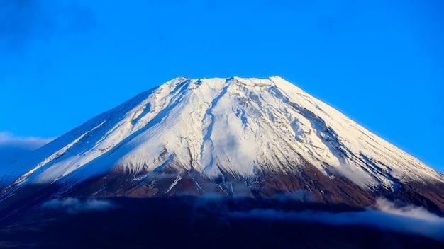 Closeup fuji mountain fujisan beautiful snowcapped volcano and blue sky background