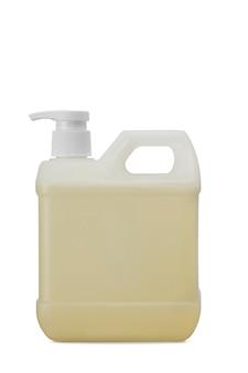 白い背景で隔離の詰め替えドロッパーポンプと黄色の石鹸のクローズアップガロンボトル-コロナウイルスとcovid-19予防の概念