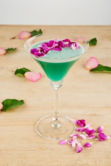 Closeup of garnished green cocktail on the floor