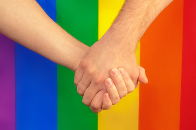 Closeup of a gay couple holding hands