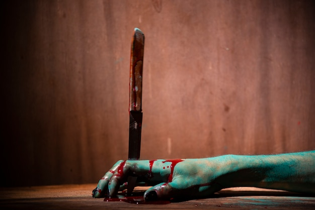 Closeup, ghost woman or zombie hold knife for kill with blood violence in house