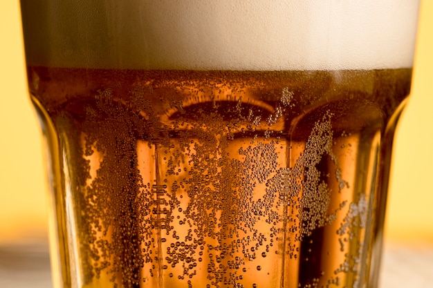Closeup glass of cold beer with golden bubble