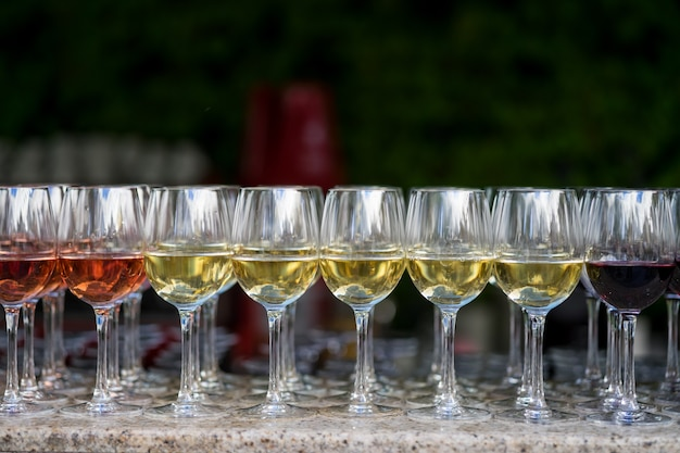 Closeup of glasses with many types of wine
