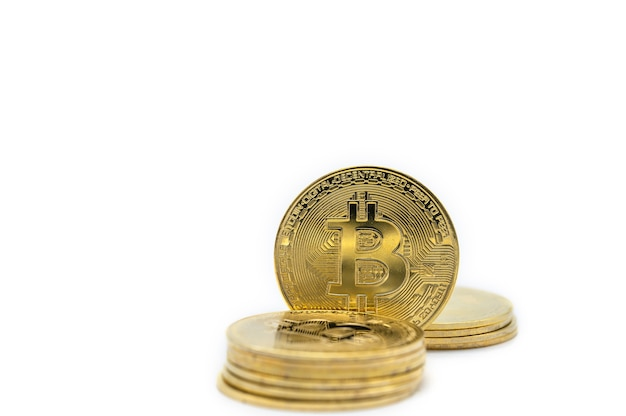 Closeup of gold bitcoin coins isolated on white background.