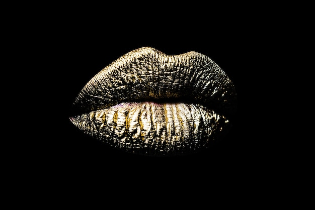 Closeup gold lips woman sexy golden lip makeup isolated on black background