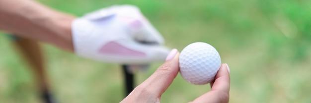 Closeup of golf balls in female hands