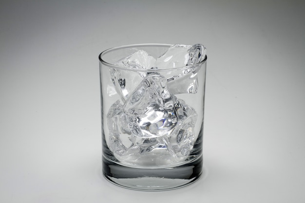 Closeup gray scale shot of a glass full of ice cubes isolated