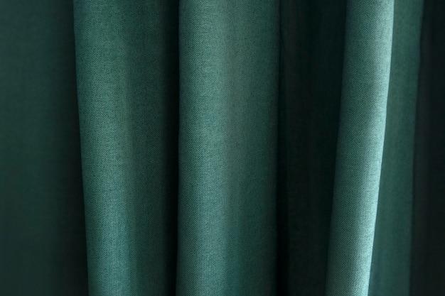 Primo piano di tessuto verde con pieghe
