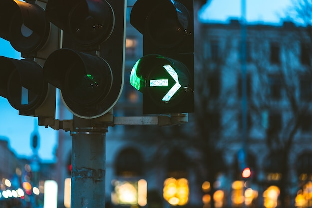 Closeup of the green traffic light in the evening