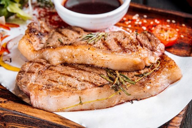 Closeup on grilled juicy steaks with rosemary