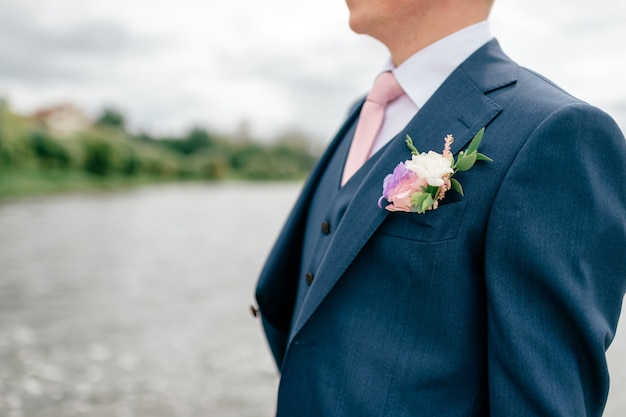 Closeup of groom in blue suit