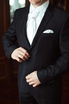 Closeup grooms wedding suit