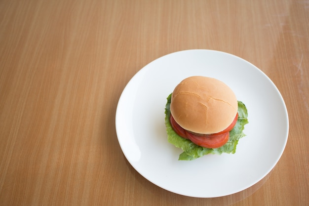 Closeup of hamberger, it's junk food put on woodentable in food court