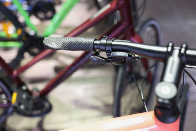 Closeup of hand brake on handlebar of bicycle in workshop repair and maintenance of bicycles