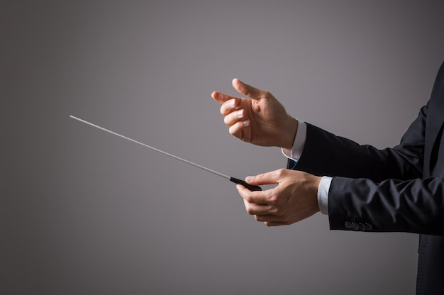 Closeup of hand of conductor ready to direct