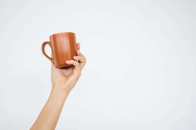 Closeup hand holding cup of coffee in white background. clipping paths