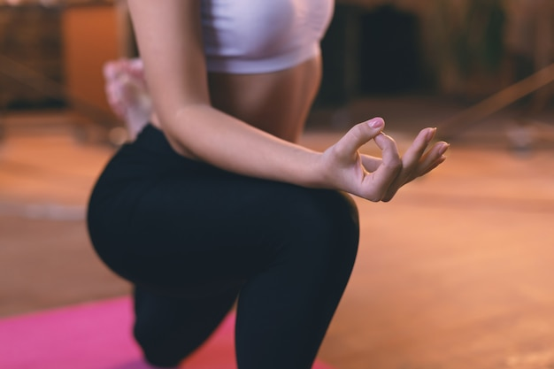 Closeup hand  of a young girl doing yoga on the floor