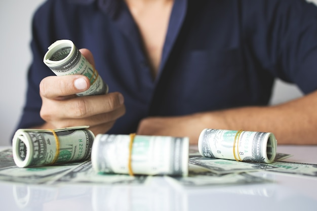 Closeup hands holding us dollar bills with soft-focus