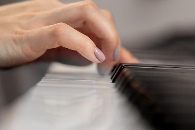 Closeup of hands playing piano.