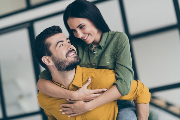 Closeup   handsome husband guy and his wife lady spending honeymoon in modern luxury country penthouse flat holding piggyback
