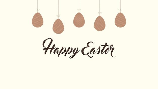 Текст и яйца пасхи крупного плана счастливые на коричневой предпосылке. роскошный и элегантный шаблон динамичного стиля для праздника