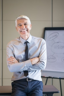 Closeup of happy senior expert with flipchart