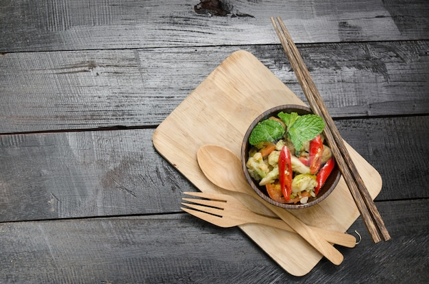 Closeup, healthy broccoli stir fry in cup wooden