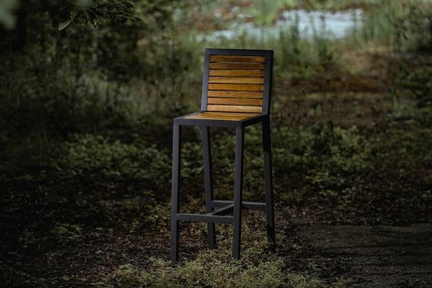 Closeup of a high loft-style chair in the evening garden