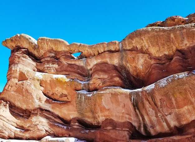 Closeup of high rocks in a desert with amazing textures and a blue sky