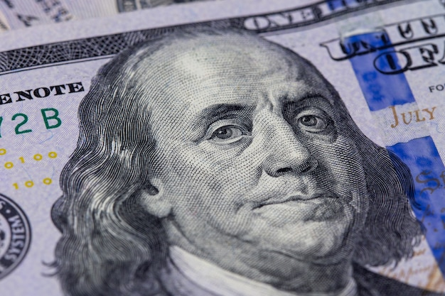 Closeup of a hundred dollar bill. benjamin franklin's portrait