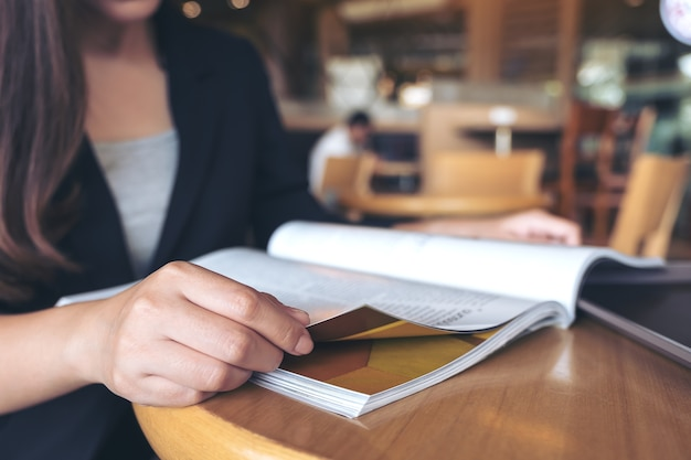 Closeup image of a business woman reading a book in modern cafe